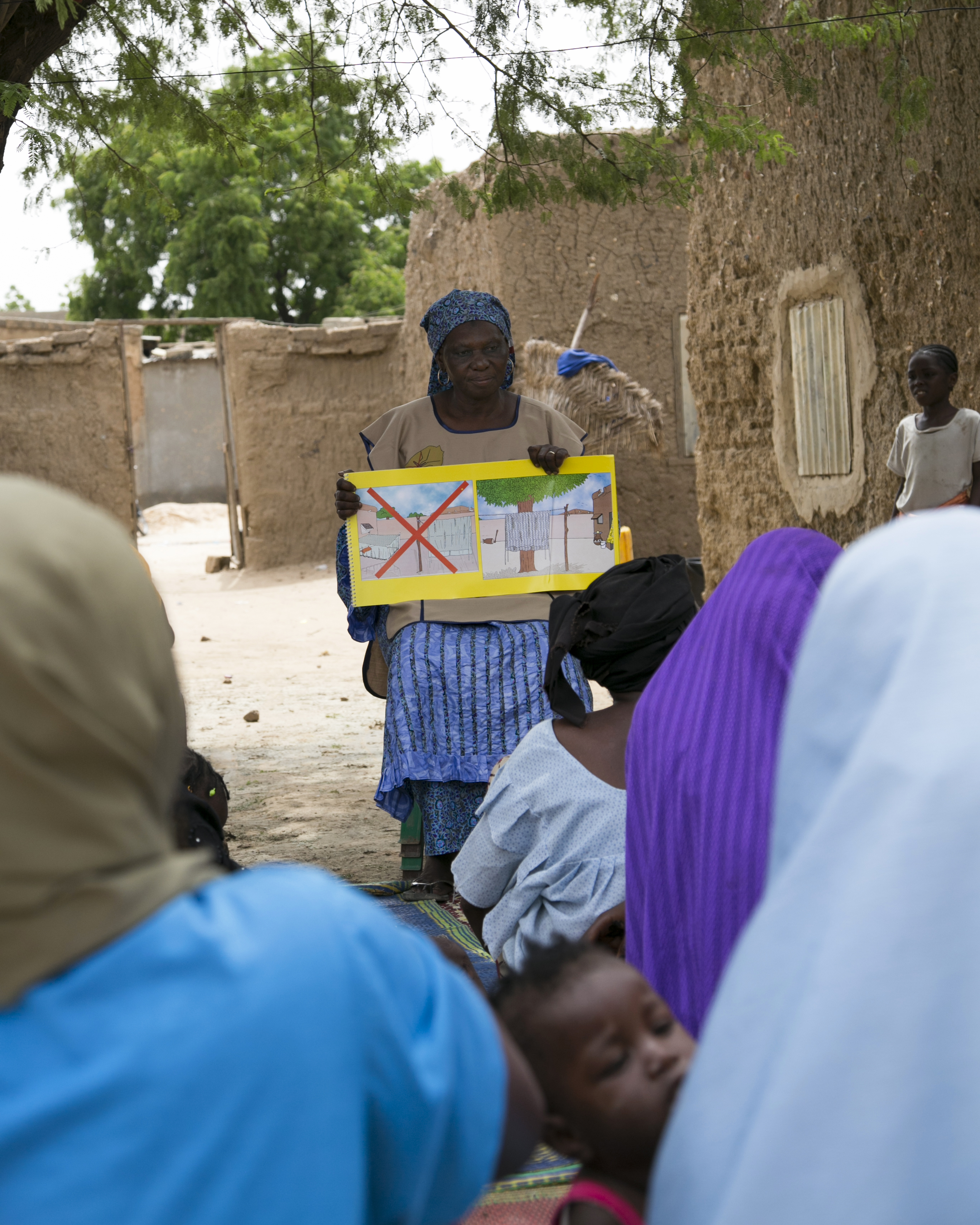 Seydou Fati, a community volunteer in Niger, educates communities about the importance of malaria prevention, including the use of insecticide-treated mosquito nets. Photo by Michael Stulman/CRS