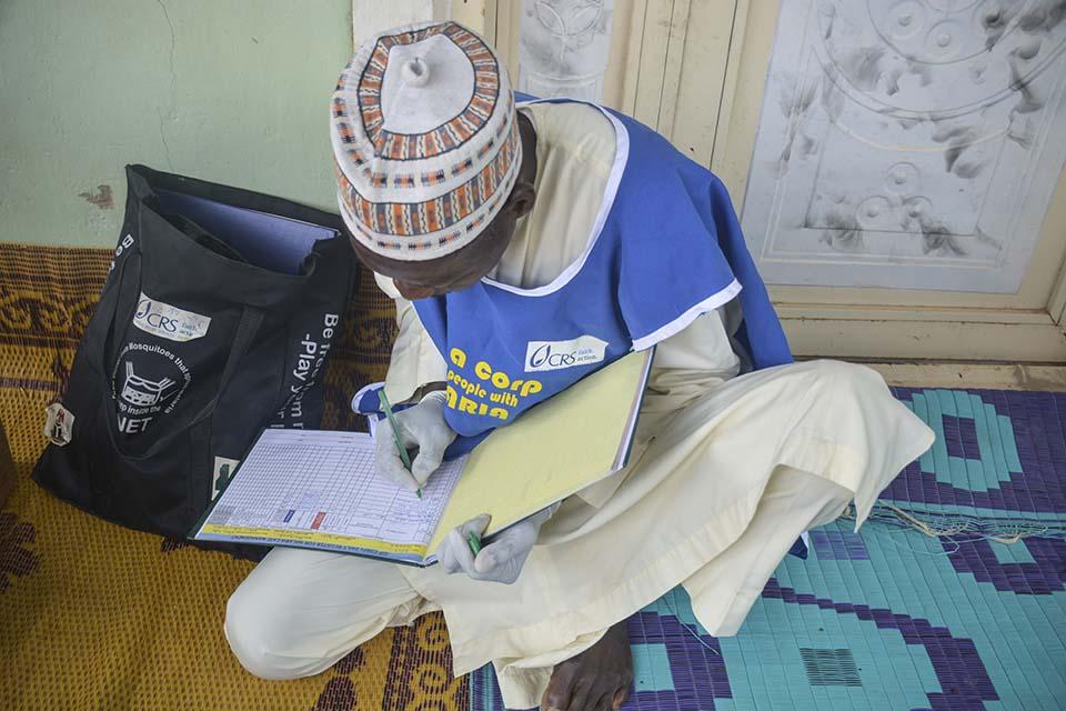 Nigerian volunteer with malaria testing kit