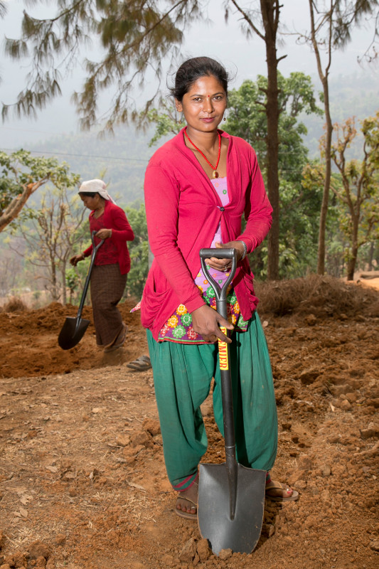 Kalpana Shrestha participates in training for unskilled workers on earthquake-resistant construction techniques. It will allow her to work with a CRS-trained skilled mason.
