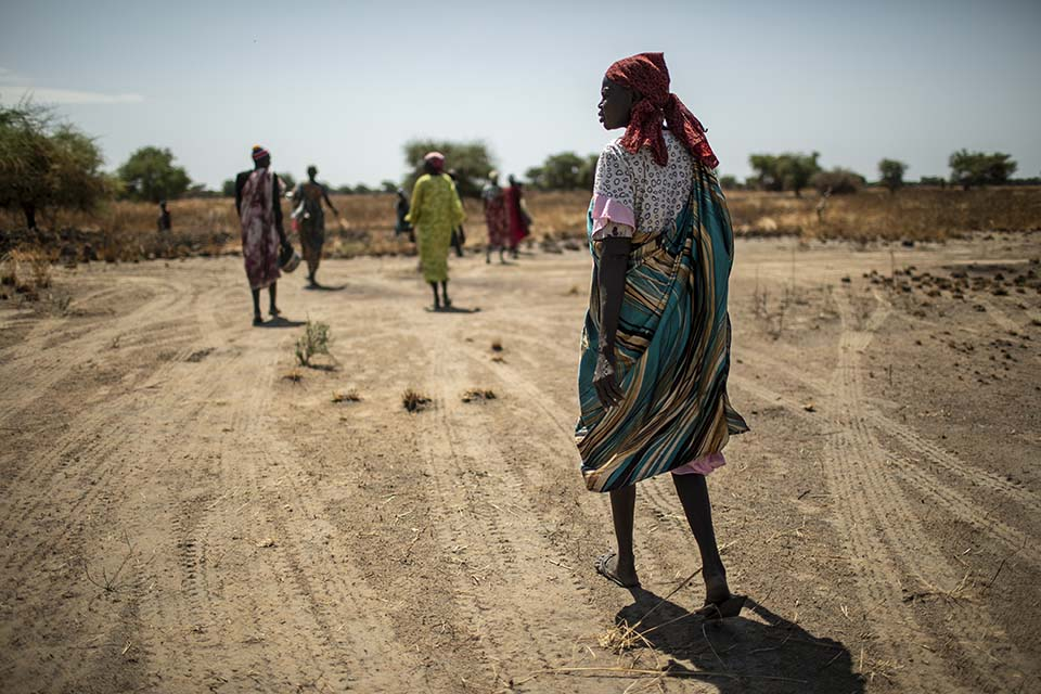 women walk parched landscape in South Sudan