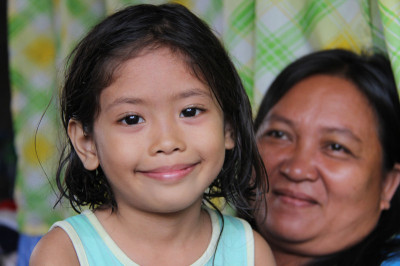 Amid the ruins of the Cagayan de Oro flooding emergency of 2011, CRS met this Filipina girl, celebrating her fifth birthda. For many children in the world, reaching the age of 5 can mean the difference between life and death. Photo by Jennifer Hardy/CRS