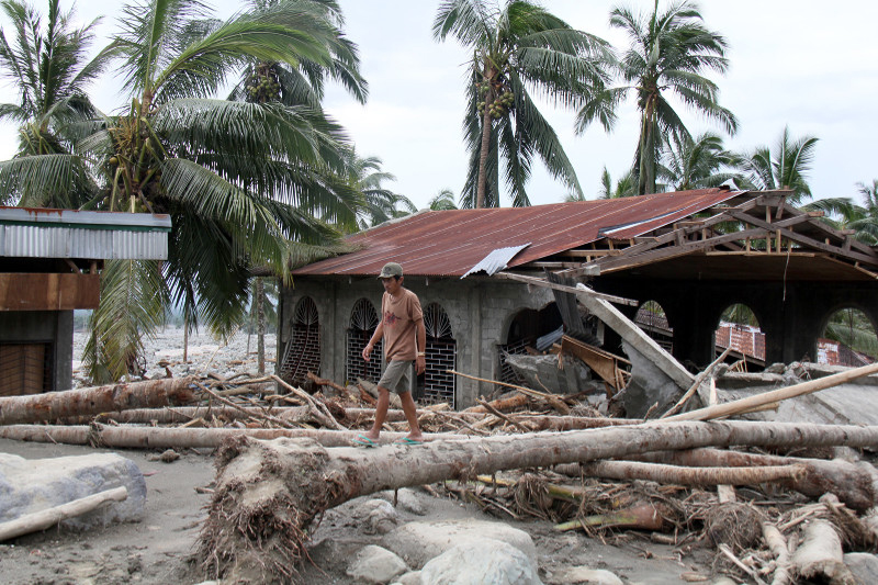 A mudslide wiped out the local Church after flooding from Typhoon Bopha, which also destroyed more than 100,000 homes in 2012. Photo by Jennifer Hardy/CRS