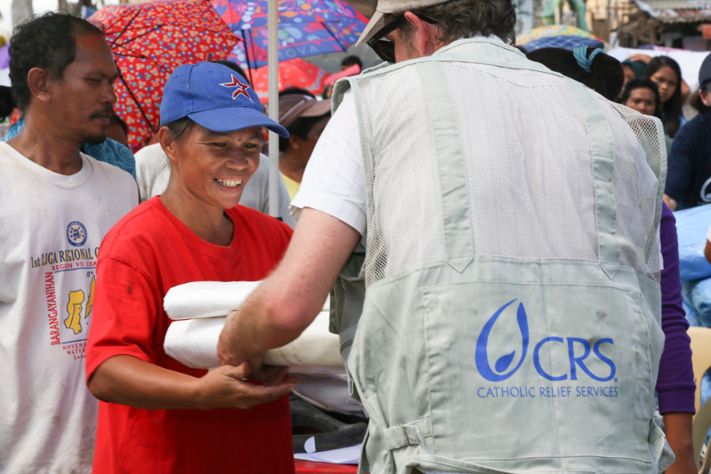 CRS distributes plastic tarps for emergency shelter in the town of Palo after a deadly typhoon in the Philippines.