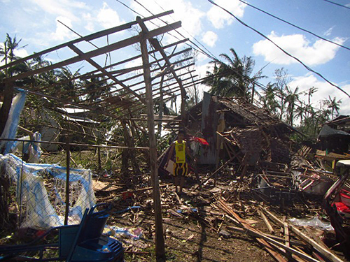 On the island of Samar, where Typhoon Hagupit made landfall on December 6, 2014, many houses made from light materials like nipa and bamboo suffered extensive damage, collapsed or had their roofs blown off. Photo by CRS staff.