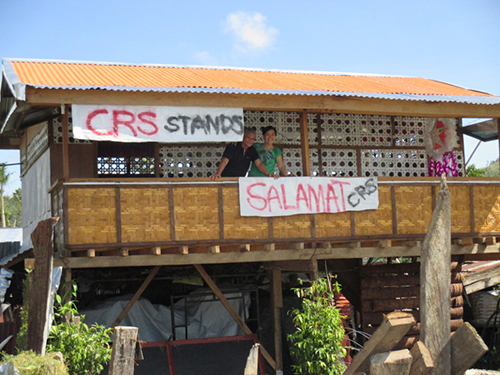 Esperanca and Benedicto Militante, Sr., residents of Palo, Leyte, are grateful their house withstood Typhoon Hagupit. CRS helped them build a storm-resistant home after last year's devastating Typhoon Haiyan. Photo by Charlie David Martinez for CRS