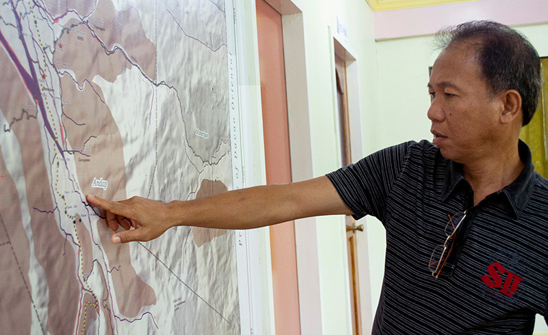 Mayor Lorenzo Balbin Jr. of New Bataan, Philippines, shows his town's typhoon risk map. New Bataan was ravaged by Typhoon Bopha in 2012. Photo by Maria April dela Cruz/CRS