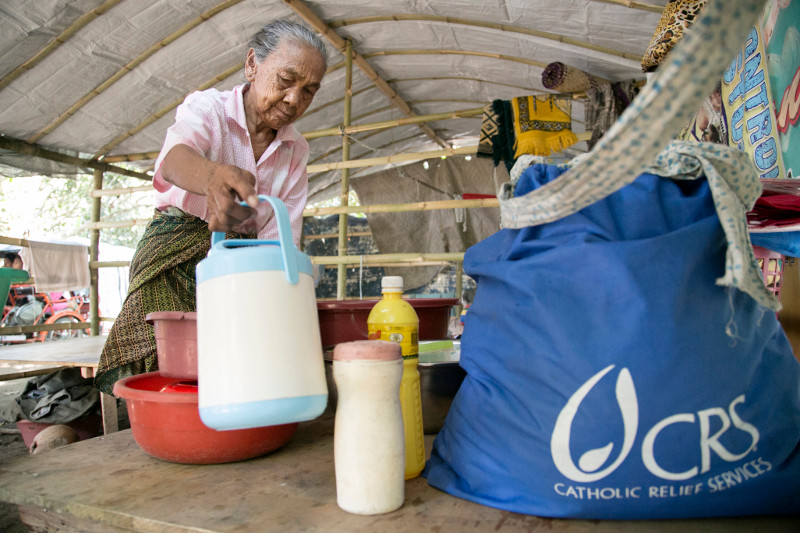 CRS has made Siyang Dipatuan's morning routine a little easier by providing essential household goods. Photo by Jennifer Hardy/CRS