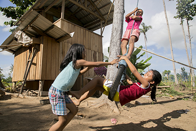 Thanks to a CRS cash-for-shelter project, the Bretenia and Dagami girls—cousins, neighbors and best friends—now have safe, sturdy homes. Photo by Jennifer Hardy/CRS