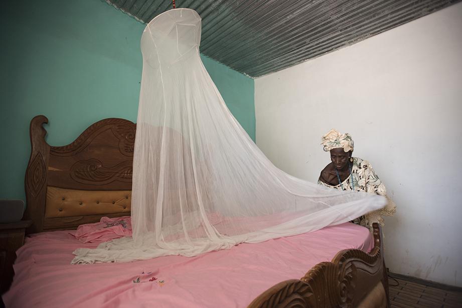 preparing a malaria net in the gambia