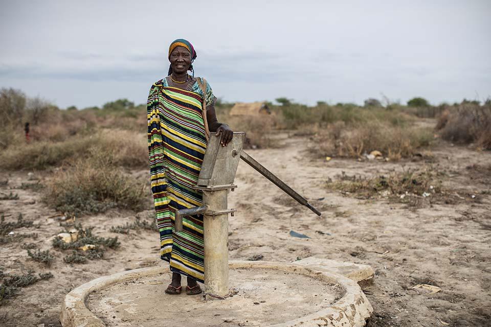 pump mechanic standing near well in South Sudan