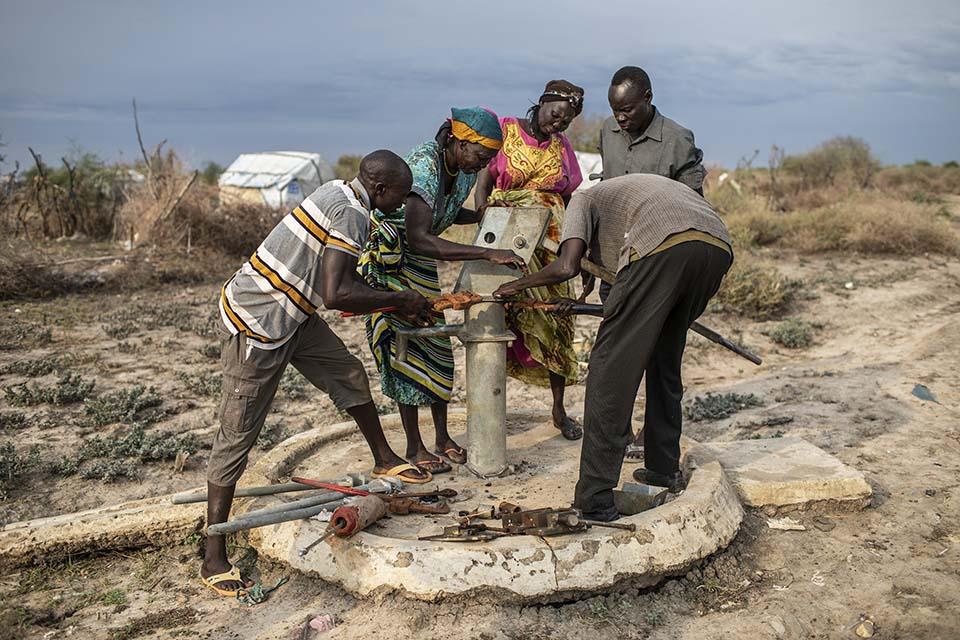 pump mechanics dismantle a well pump in South Sudan