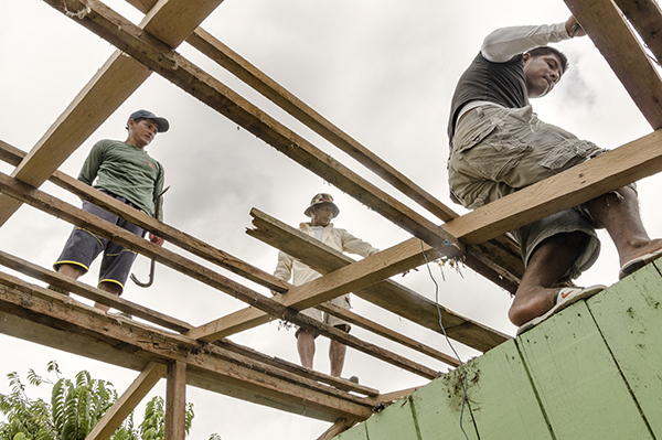 workers rebuild after Eucuador earthquake