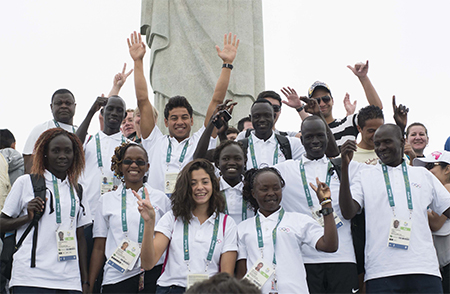 The first-ever Olympic team of international refugee athletes, representing over 65 million refugees worldwide, poses together before participating in the summer games in Rio de Janeiro, Brazil.