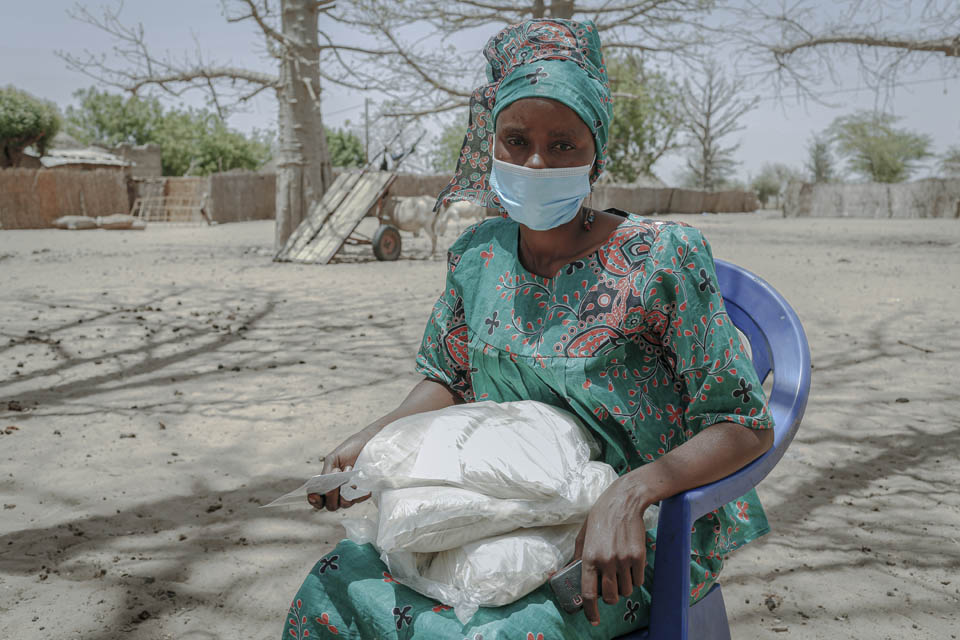 Senegal mother with food supplies