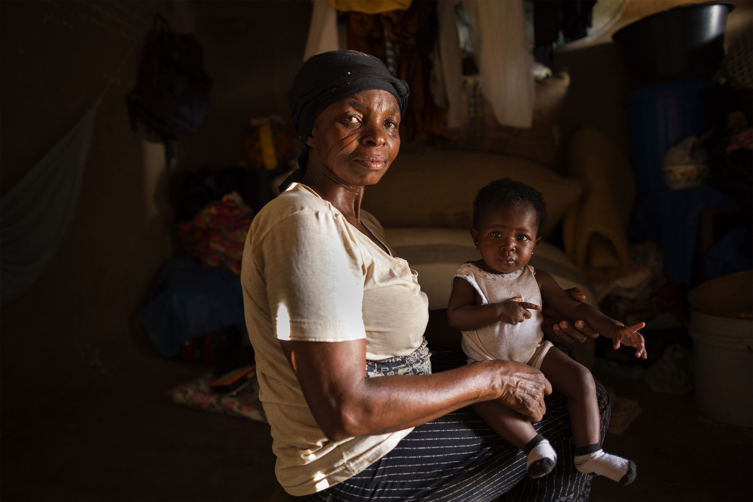 The ability to earn money through farming is Ghana is often limited because of climate change. But women like Rita are using earnings from the CRS' savings groups to start a shea nut butter business. Photo by Jake Lyell for CRS