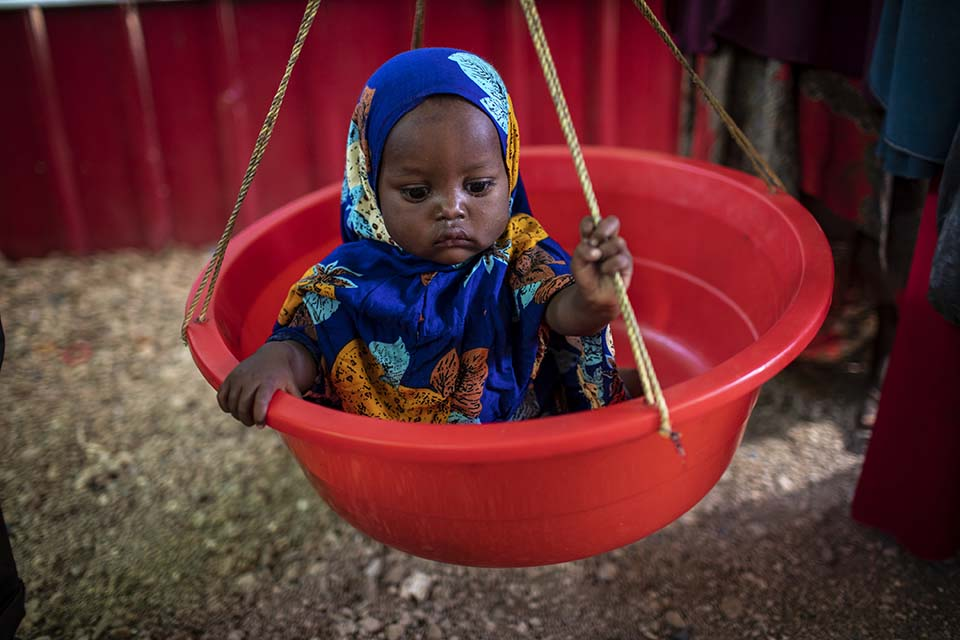 child weighed in Somalia clinic