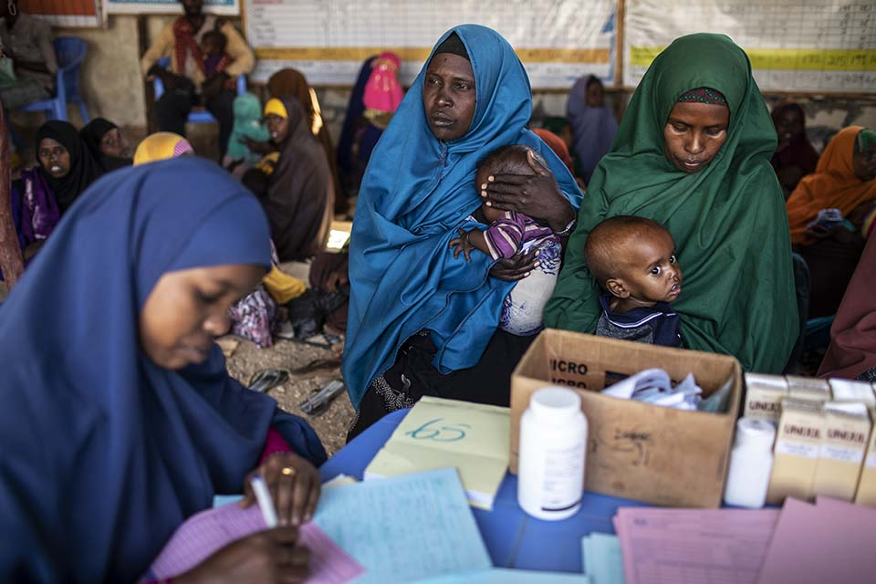 Somalia mother and child visit a health clinic