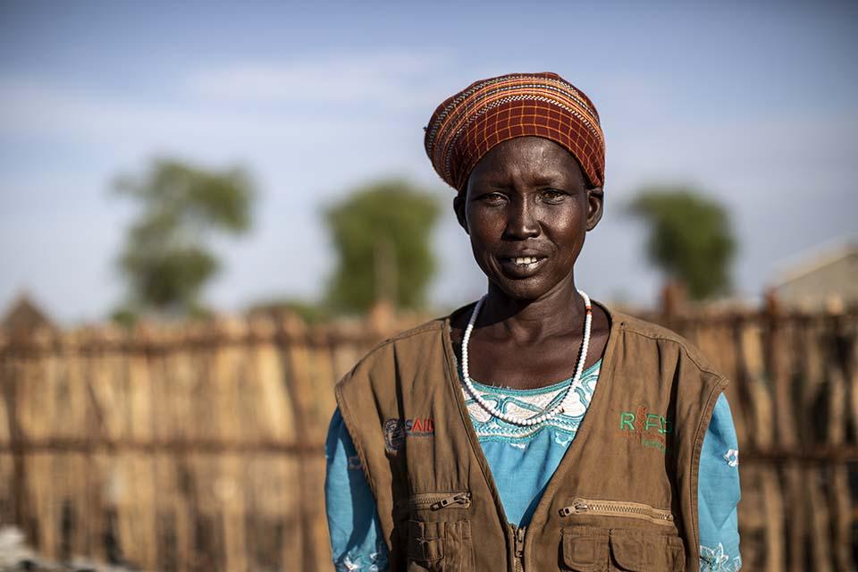 South Sudanese committee member facing camera