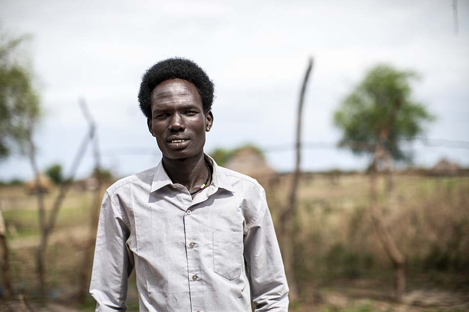 South Sudanese man standing outside