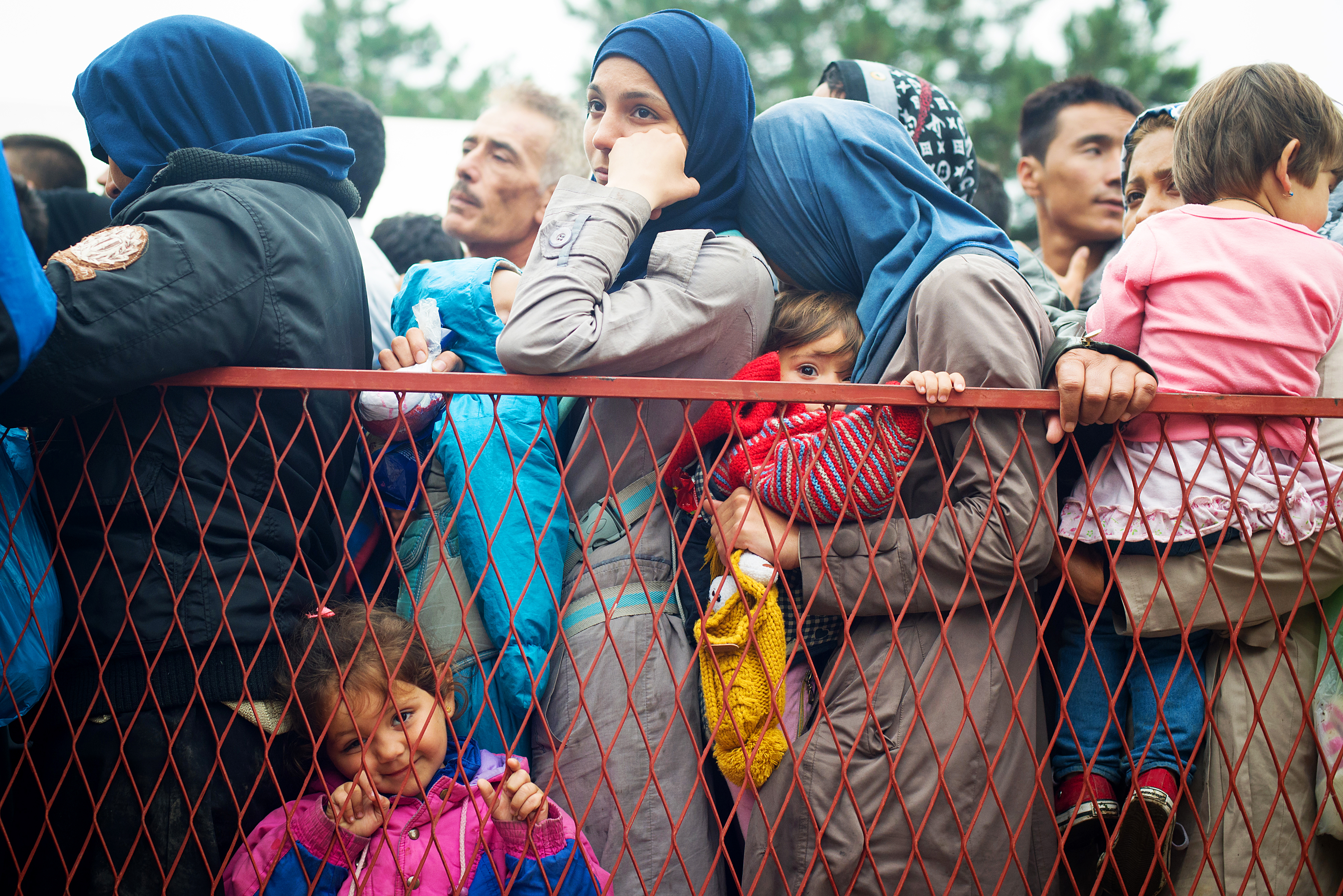 Refugees wait for transportation to the Hungary border at a park near Belgrade, Serbia.CRS has served nearly 63,000 refugees with food, emergency supplies, and medical and other assistance. Photo by Kira Horvath for CRS