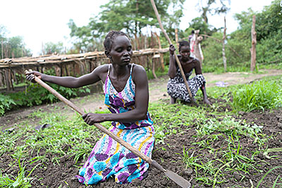 Farmers in the Tuktiop group get ready to transplant tree seedlings. Members have learned that the young plants require time in the nursery's soil before they're ready to sell. Photo by Sara A. Fajardo/CRS