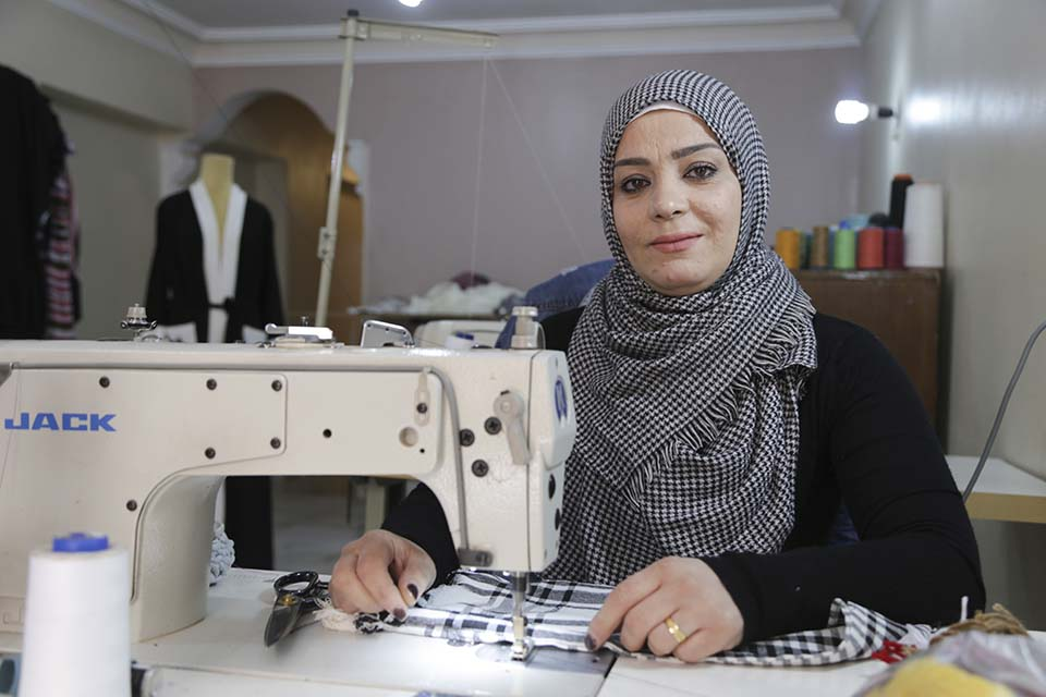 Syrian refugee business woman with her sewing machine