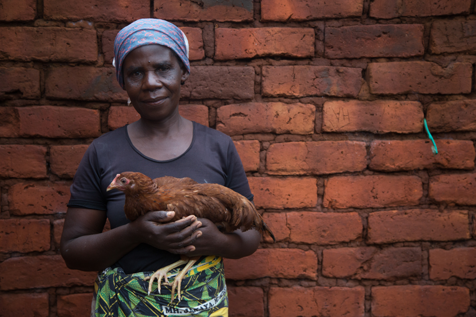 woman with chicken in Tanzania