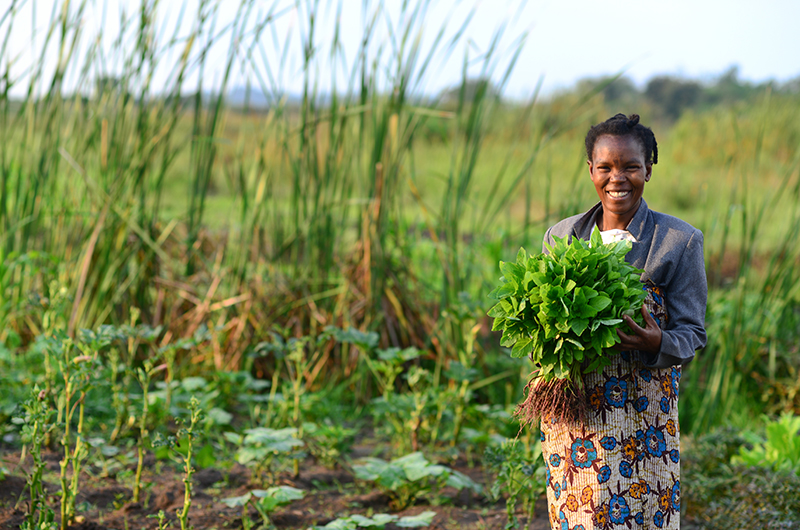 In Tanzania, Mama Teddy used seeds from CRS to grow healthy food--both for sale and to feed to her three children.