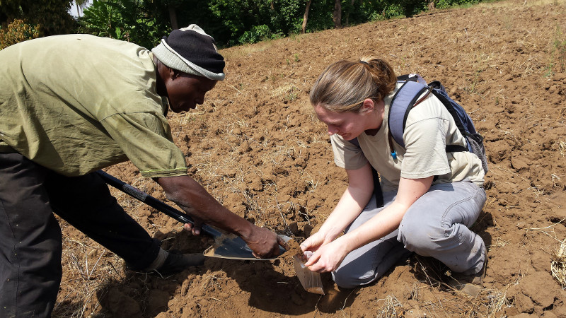 Shea Belahi, right, takes soil samples with a community member on a farm in Tanzania. Shea traveled to Tanzania in January 2015 as part of CRS' Farmer-to-Farmer program. Photo courtesy of Sebastian Assenga