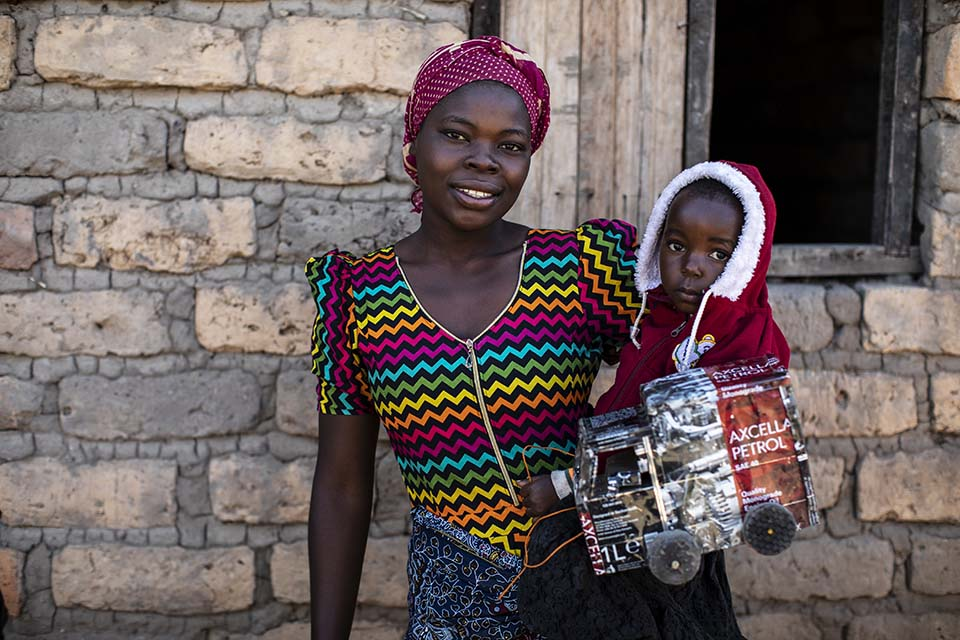 Tanzanian mother holding her child