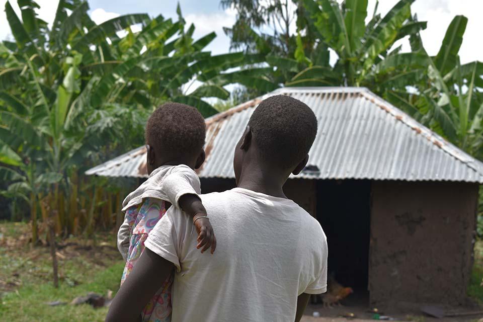 teen mother holding child in Kenya