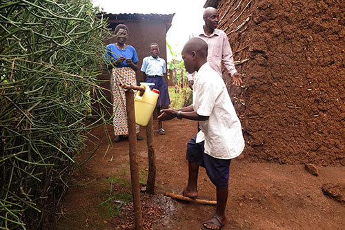 tippy tap improves family hygiene in Rwanda
