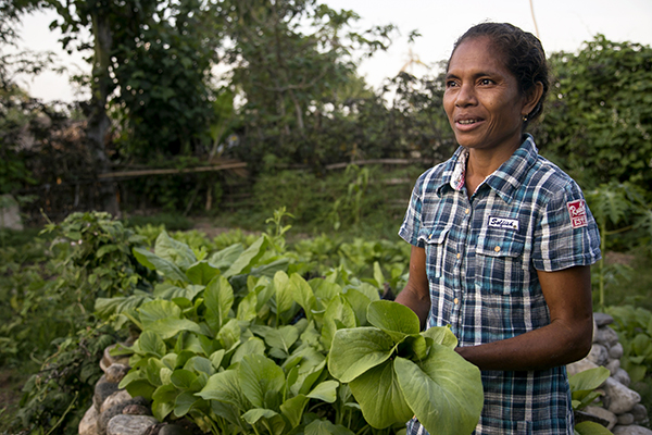Joana Mascarenhas tends a model garden, which demonstrates different planting techniques to help families learn to grow more nutritious foods and sell surplus produce.