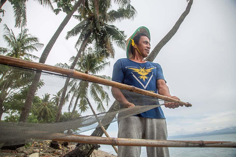 tsunami survivor with fishing net