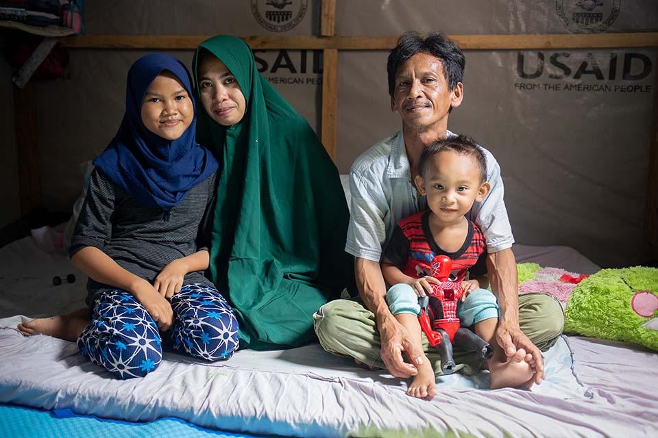 tsunami survivors in shelter