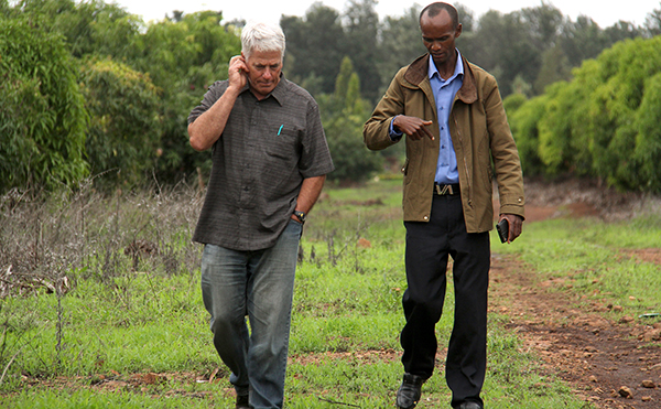discussing business in a Kenya field