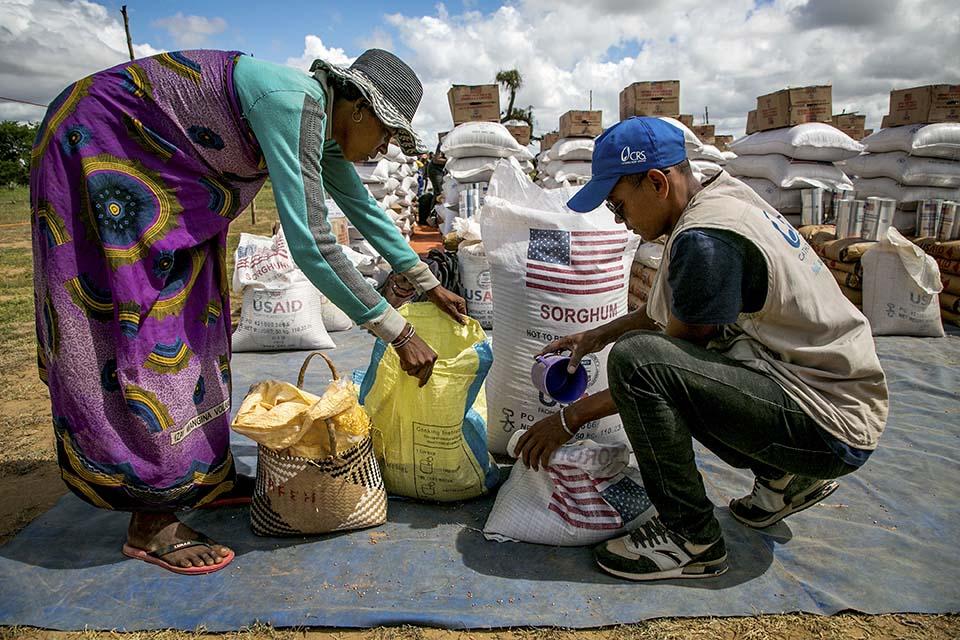 two people preparing supplies in Madagascar