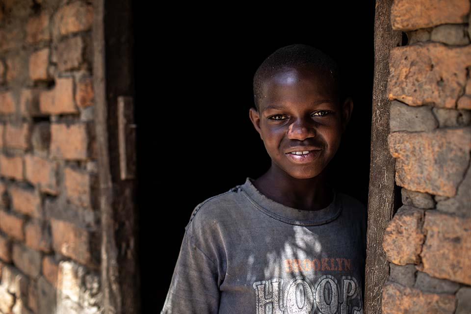 Uganda girl in doorway