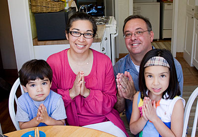 From left, Lucas, Sonia, Chris and Marina Arriola of California use Operation Rice Bowl to help them observe Lent from a global perspective. Photo by Philip Laubner/CRS
