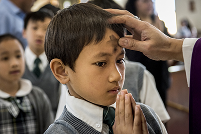 Ash Wednesday is the first day of Lent, a 6-week period dedicated to prayer, fasting and almsgiving in preparation for Easter. Photo by Karen Kasmauski for CRS