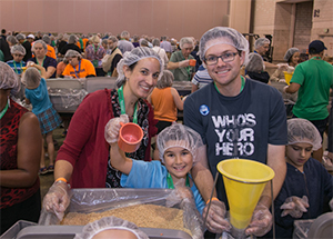 Almost 3,000 people joined together to package 255,848 meals for Burkina Faso at September's World Meeting of Families as part of the Helping Hands program.