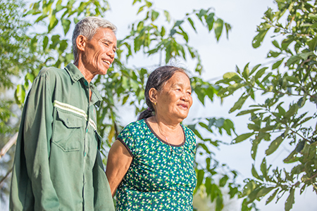 Tue's increased yields have also meant more income to spend on medicine for his wife Bui Thi Lien.