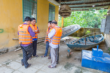 A support group prepares to run a mock flood evacuation drill using new CRS-funded aluminum boats.