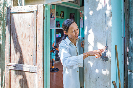 Phuoc applies some of the home maintenance skills she learned to ensure her household is storm resilient.
