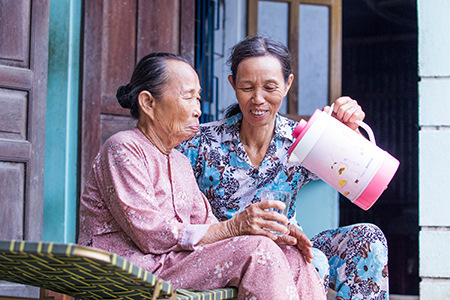 Le Thi Phuoc and her elderly mother can now sleep well at night, knowing their home's new roof can stand up to the fierce storms that lash their small village in central Vietnam.