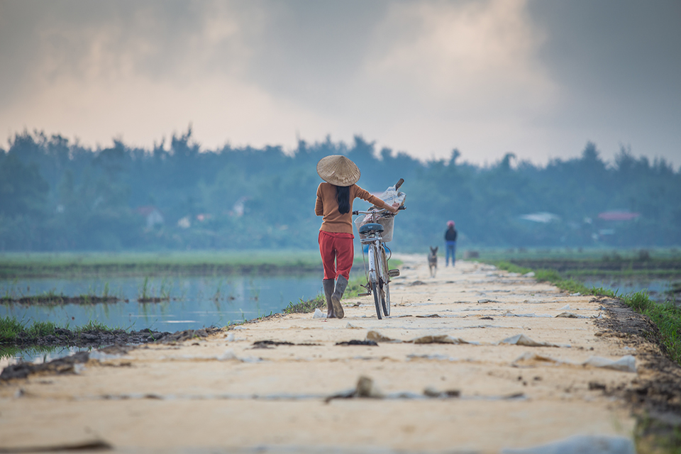walking with bike in Vietnam