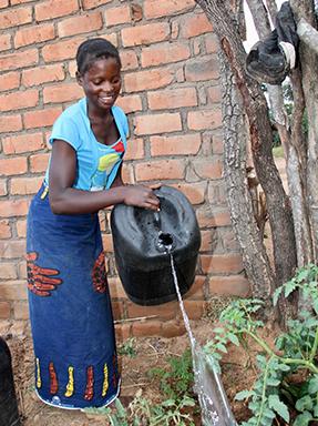 watering garden in Zambia