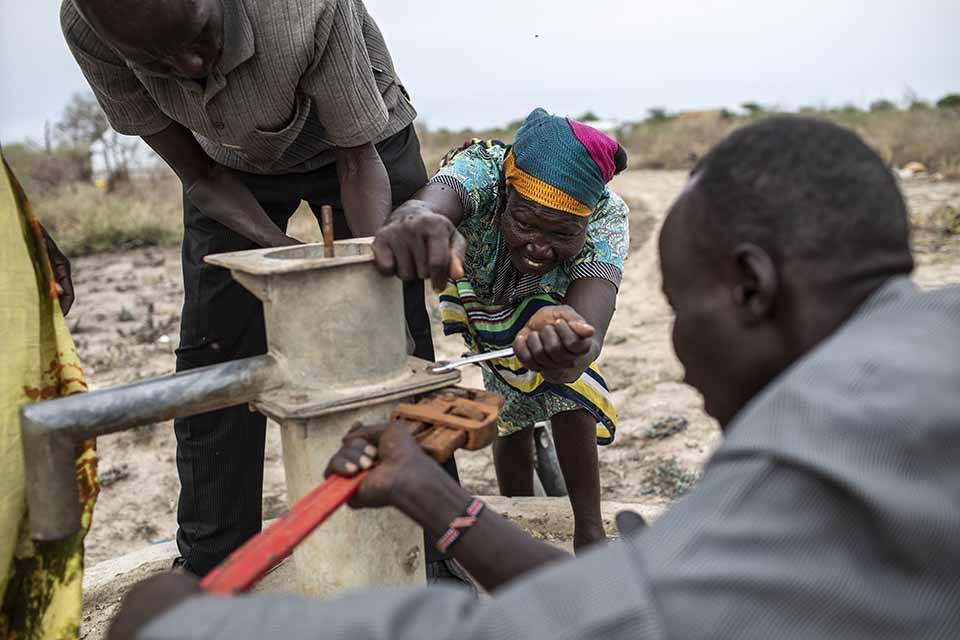 well pump mechanics dismantle a pump in South Sudan