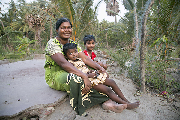 woman with grandchildren in Sri Lanka