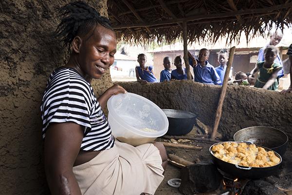 woman cooking in her shop in Sierra Leone